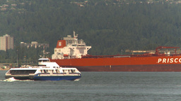 HD2009-6-31-26 cargo ship and harbour ferry Stock Video Footage