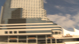 HD2009-6-31-28 office tower and cruise ship Stock Video Footage