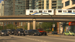 HD2009-6-32-26 traffic skytrain and condos Stock Video Footage