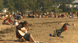 HD2009-6-32-45 guitar player on beach Stock Video Footage