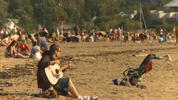 HD2009-6-32-45 guitar player on beach Footage