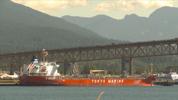 HD2009-6-33-17 traffic over bridge and ship Stock Video Footage