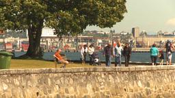 HD2009-6-34-10 walking the seawall Stock Video Footage
