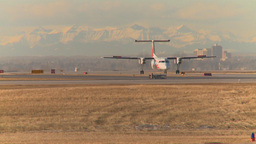 HD2009-3-1-11 Dash-8 taxi Mtns in bg Stock Video Footage