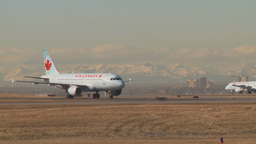 HD2009-3-1-15 Airbus and Boeing taxi mtns in bg Stock Video Footage