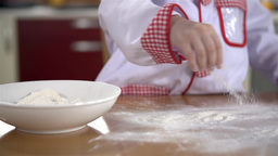 Spreading Flour On Table In Slow Motion Close Up stock footage