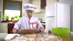 Little Cook With Big Rolling Pin stock footage