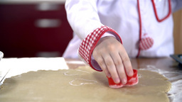 Child Hand With Stamp Making Valentine Cookies stock footage