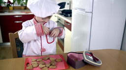 Funny Cook Smelling Cookies Before Packing In Vale stock footage