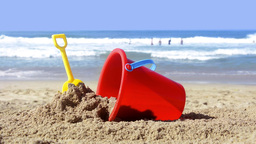 Beach bucket in sand Footage