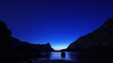 Mountain Lake. Day follows night. Pamir, Tajikista Footage