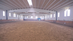 Wide Shot Of Olympic Horse Ride In Huge Bright Rid stock footage
