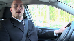 Slow Motion Businessman Driving Car Chewing Gum stock footage