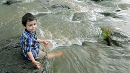 Child having fun at the riverside Footage