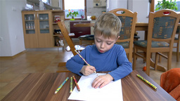 Slow Motion Dolly Creative Kid Drawing On Paper stock footage