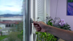 Closing Iron Blinds On Windows Slow Motion PRORES stock footage