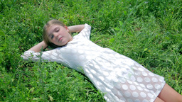 Girl Sleeping In Grass And Waking Up stock footage