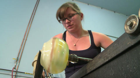 Glass blowing, shaping hot glass bowl Footage