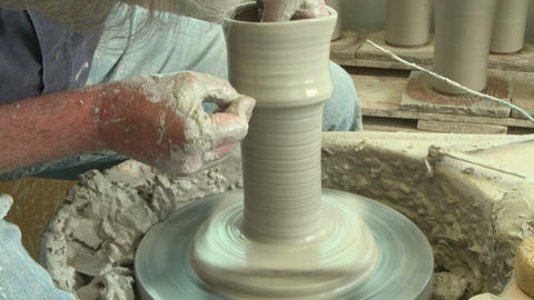 Potter shaping a tall clay vase Footage