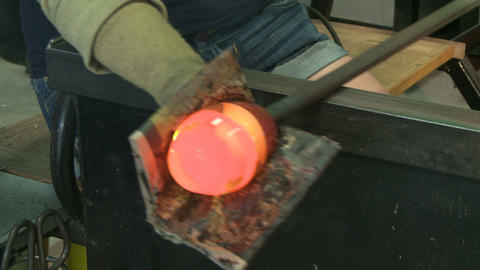 Glass blower working in studio Footage