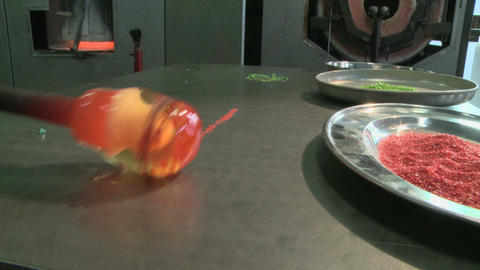Glass blower, adding colored glass Footage