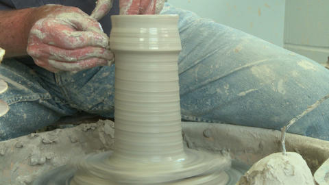 Potter shaping a tall vase f 5 Footage