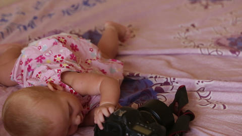 child blond in dress lying on bed Footage