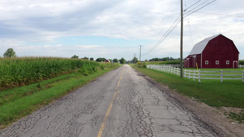 Country road with barn Footage