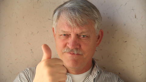 older man with thumbs up Footage