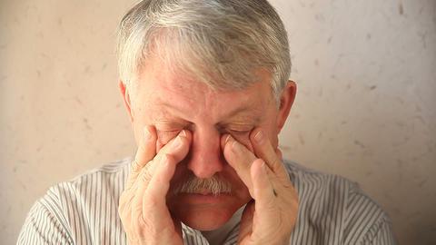 man massaging eye area Footage