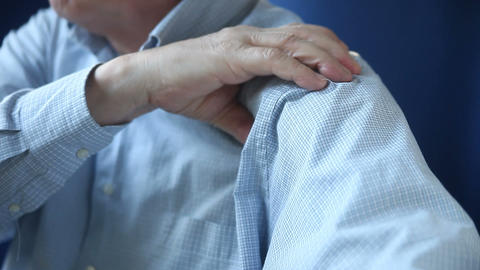businessman rubbing sore shoulder Live Action