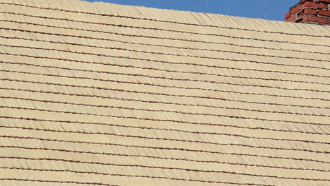 Wooden roof tiles and a brick chimney at top Footage