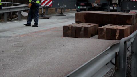 Piled blocks equipments of wood and men walking aw Live Action