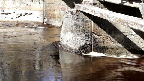 River flowing on big rock at the bridge Footage
