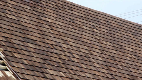 Half Finished Pine Tared Cedar Wooden Shingle Roof stock footage