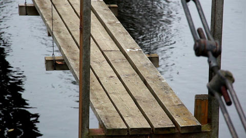 Closer image of the wooden hanging bridge Footage