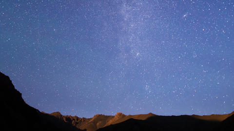 Stars over the mountains. Time Lapse Footage
