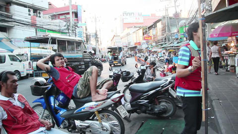 PATTAYA, THAILAND - AUGUST 9, 2014: Motorbike Taxi stock footage