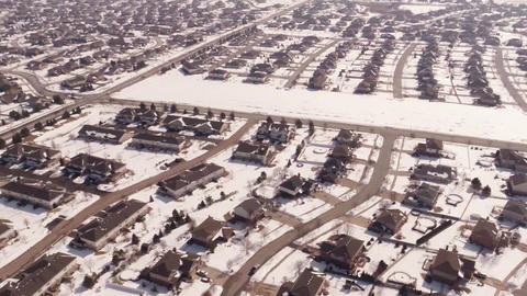 Aerial of homes in a snow covered suburban neighbo ビデオ