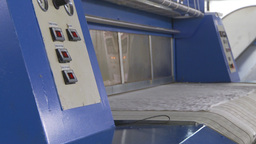 HD2009-11-9-16 industrial laundry machines folding Stock Video Footage