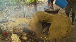 HD2009-11-12-35 sugar cane still fire pour liquid Footage