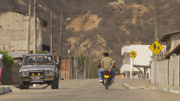 HD2009-11-13-9 motorcycle small village Ecuador Stock Video Footage