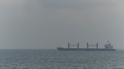 HD2009-11-14-17 distant cargo ship horizon Stock Video Footage