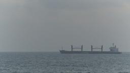 HD2009-11-14-17 distant cargo ship horizon Stock Video Footage