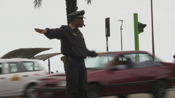 HD2009-11-15-4 policeman directs traffic Stock Video Footage