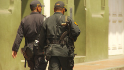 HD2009-11-16-7 police walking with AK47 Footage
