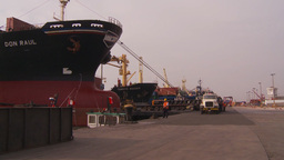 HD2009-11-16-41 cargo ships and trucks dock Stock Video Footage