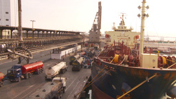 HD2009-11-16-49 cargo ships and trucks dock Stock Video Footage