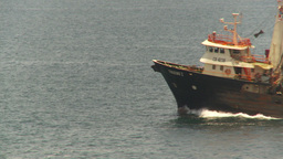 HD2009-11-18-2 fishing boat heading out to sea thro frame Stock Video Footage