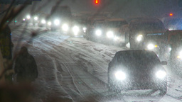 HD2009-11-24-12 snowstorm slow moving traffic Stock Video Footage
